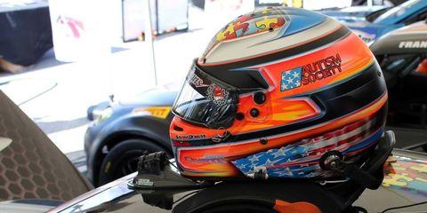 This Bell Racing RS7 carbon fiber helmet features the autism awareness logo.