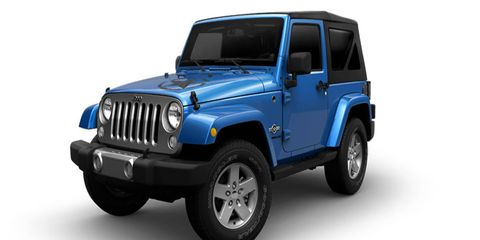 The 2014 Jeep Wrangler Freedom Edition is slathered in decals from front to back.