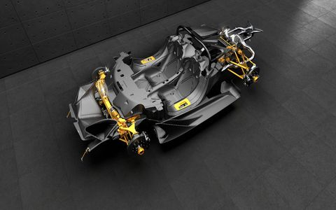 Here's what's under the wildly sculpted body of the crazy Apollo Intensa Emozione: a carbon fiber chassis supporting double wishbone pushrod suspension front and rear.