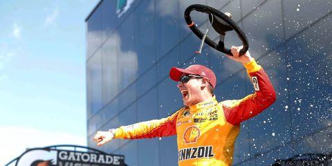 Joey Logano celebrates his Clash win Sunday at Daytona.