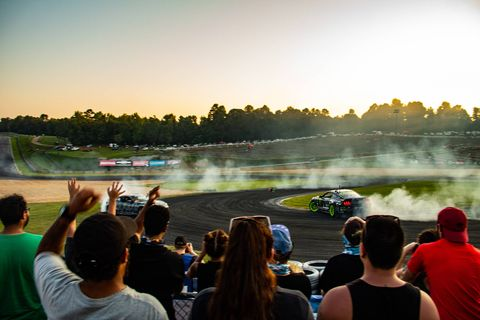 A momentarily apprehensive crowd cheers as Formula DRIFT Pro Series drivers Vaughn Gittin Jr. and Ryan Tuerck drift head on at Road Atlanta's Turn 10 Drift Zone during the last drift session of the day at Gridlife South on Aug 25, 2018. (Brooks Metzler 2018)