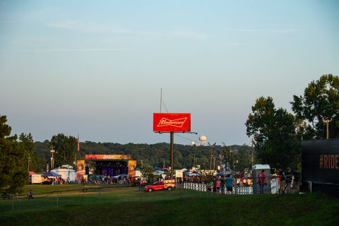 Sun sets over the rolling hills of northeast Georgia as the on track festivities of Gridlife South give way to the evening's music performances. Artists at this year's Gridlife South included DJ duo Slander and Atlanta-based rapper Killer Mike. (Brooks Metzler 2018)