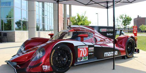 Mazda IMSA race car outside Martin Luther King Jr. High School in Detroit.