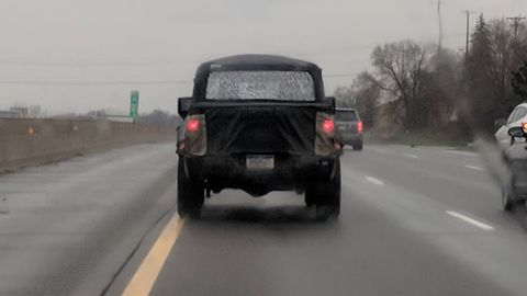 We spotted the 2019 Jeep Wrangler Scrambler pickup testing in metro Detroit.