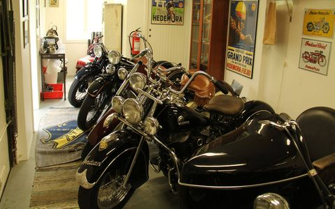 A whole row of perfectly restored Indian motorcycles.