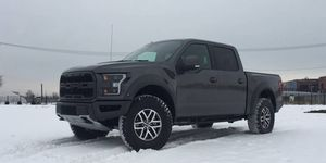 The Ford F-150 Raptor's 3.5-liter V6 makes 450 hp at 5,000 rpm and 510 lb-ft of torque at 3,500 rpm. A ten-speed automatic routes power to all four wheels, shod with BFGoodrich all-terrain tires.