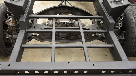 The rear frame structure contains supports for the fuel cell.