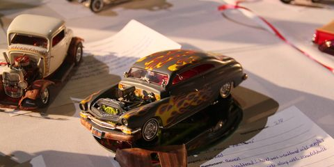 We all grew up building scale models of our favorite cars (then blowing them up with firecrackers). Some of us kept building them. The best of those gather each year at the Petersen Automotive Museum in Los Angeles. Here are some of the car models.