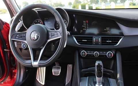 The Alfa Romeo Giulia Ti has a relatively simple interior layout with an 8.8-inch touchscreen sprawling across the dash.