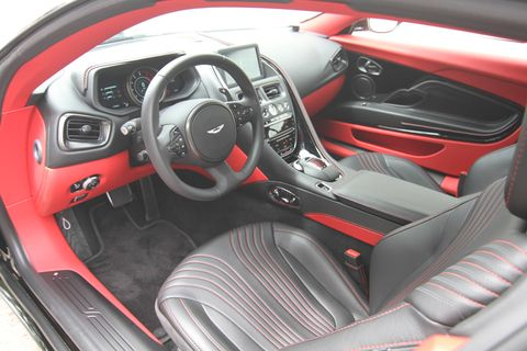 The 2018 Aston Martin DB11 has many choices for interior colors; this color is called spice red.