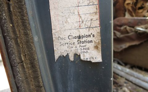 The alphanumeric phone number for Doc Champion's Service Station in Boulder indicates that the oil-change sticker is from the late 1950s or earlier.