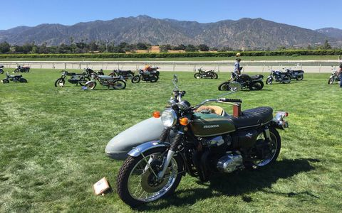 That's a Honda CB750 with sidecar. Yes, there is a dog in the sidecar, but it's a fake dog.