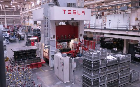 Stamping out Model S hoods at the Tesla Plant.