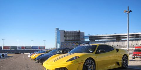 Supercars lined up at Texas Motor Speedway for Fittipaldi Exotic Driving