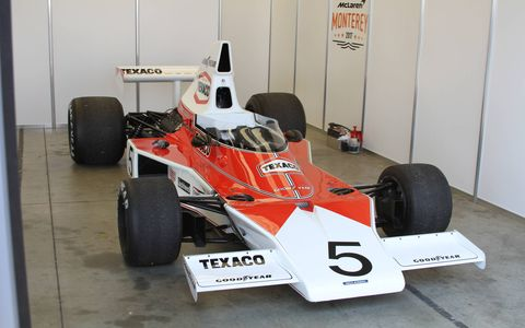 Mika Hakkinen climbs into the McLaren M23 once driven by Emerson Fittipaldi to win the 1974 Formula One Driver's World Championship