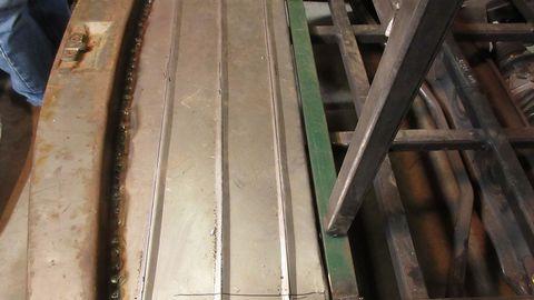 Sheet metal in the trunk floor area.