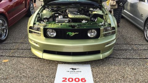 The green runs from the body to the engine compartment in this 2006 Ford Mustang GT.