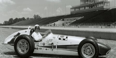 A.J. Foyt poses with his 1961 Indy 500-winning car. It was the first of Foyt's four Indy 500 wins.