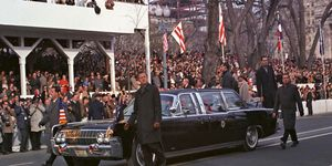 The X-100 was redesigned and put back into service after Kennedy's death. Here it wears a special inauguration plate during the inauguration parade of Lyndon Johnson in 1965.