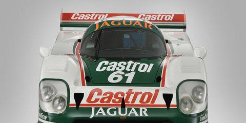 Performance car, Automotive design, Headlamp, Car, Race car, Sports car, Hood, Supercar, Logo, Automotive lighting,
