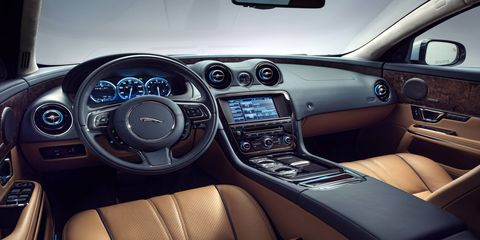 The interior of the 2015 Jaguar XJL Portfolio is still a British feast filled with leather and wood all around.