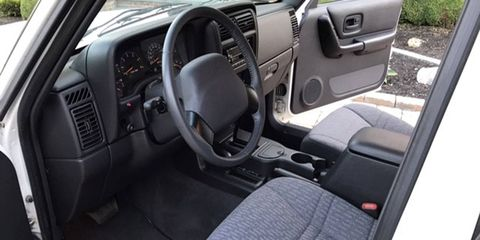The 4,400-mile 2000 XJ Cherokee was essentially never driven and still has plastic over the tape deck.