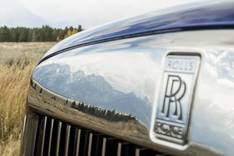 The Grand Teton reflected in the Cullinan's grand grille.