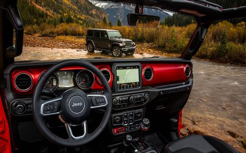 As with the rest of the off-roader, the interior of the 2018 Jeep Wrangler JL gets a big upgrade. A two-door Wrangler Rubicon (identifiable by the red painted dashboard insert) and a four-door Sahara are shown here.