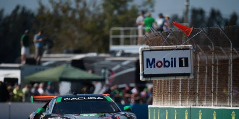 Katherine Legge driving her Acura NSX GT3 car around Sebring International Raceway