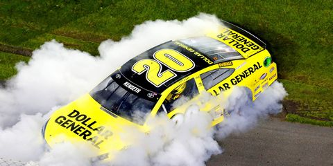 Matt Kenseth celebrates his first win of the season in the nonpoints NASCAR Sprint Unlimited on Saturday night at Daytona International Speedway.