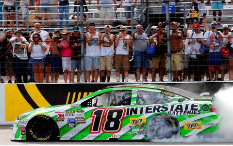 Kyle Busch celebrates his third win in the last four NASCAR Sprint Cup Series races.