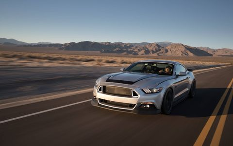 "Champion Drifter Vaughn Gittin Jr. makes Mustangs with his own body kits and suspension pieces. We drove this RTR Spec 2. ""It's fun to drive,"" Gittin said. ""It's very forgiving at the limit."""""