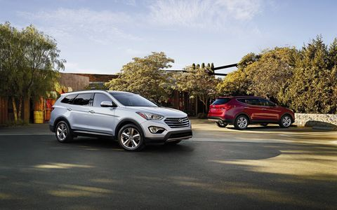 Standard features on the 2018 Hyundai Santa Fe Sport include a rearview camera, automatic on/off headlights, remote keyless entry with alarm, power side mirrors with driver's blind spot mirror, LED headlight accents, daytime running lights, steering-wheel-mounted audio and cruise control and Bluetooth hands-free smartphone system.