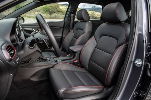 The 2018 Hyundai Enantra GT's optional Style Package adds a leather-wrapped steering wheel, heated front seats blind-spot detection and side-mirror turn-signal indicators.