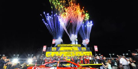 Fireworks go off behind the car of Kevin Harvick earlier this season at Homestead Miami. Harvick won the Sprint Cup championship earlier this year.