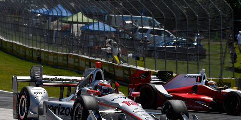 Team Penske driver Will Power celebrates after taking the checkered flag in Wisconsin on Sunday.