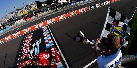 Scott Dixon takes the checkered flag at Watkins Glen on Sunday.