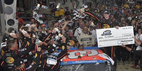 Ty Dillon held off Kyle Busch on Saturday night at the Brickyard in Indianapolis to win his first Nationwide series race,