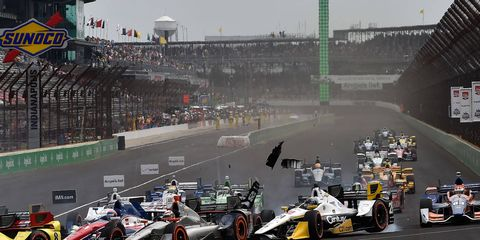 Several cars were involved in a wild first-turn incident on May 9 at Indianapolis Motor Speedway.