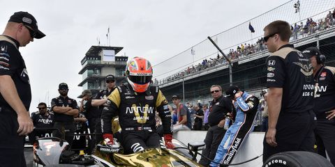 IndyCar driver James Hinchcliffe gets into his car just a day before being involved in a wreck that ended his season. He's set to get back behind the wheel next week for a test at Road America.