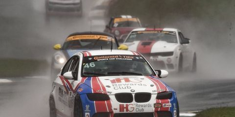 BMW's Ashley Freiberg and Trent Hindman brought their M3 to victory lane at Road Atlanta on Friday.