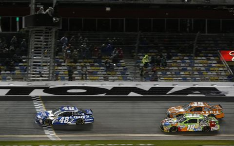 Jimmie Johnson takes the checkered flag in the second Duel at Daytona on Thursday night.