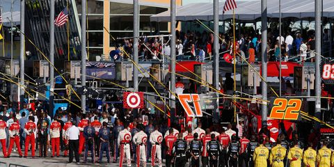 NASCAR Sprint Cup teams stand at attention during the national anthem in 2014 at Homestead.
