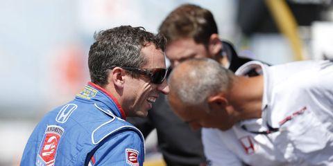 Justin Wilson, left, jokes with crew at Pocono Raceway.