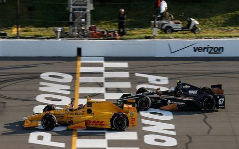 Ryan Hunter-Reay won a crash-marred Verizon IndyCar Series race at Pocono.
