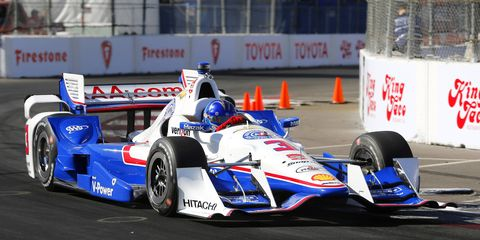 Helio Castroneves won the pole Saturday afternoon for Sunday's IndyCar race at Long Beach.