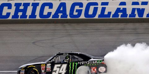 Kyle Busch celebrates his win on Saturday at Chicagoland.