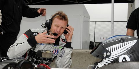 Memo Gidley gives some advice to driver Mike Guasch during the 2012 IMSA season.