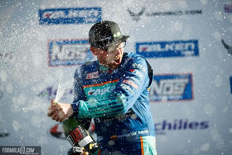 Odi Bakchis sprays the champagne after winning the season-opener at Long Beach.