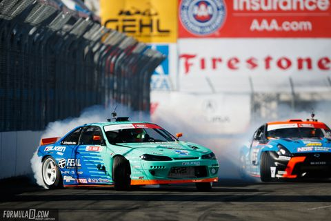 """Odi Bakchis beating Chris Forsberg in the semi-finals on his way to winning the season-opener at Long Beach to start Formula D's 16th year of sliding sideways. Forrest Wang was second and Chris """"The Force"""" Forsberg third."""